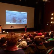 Carina Ahlqvist lecturing students on high-altitude climate expeditions